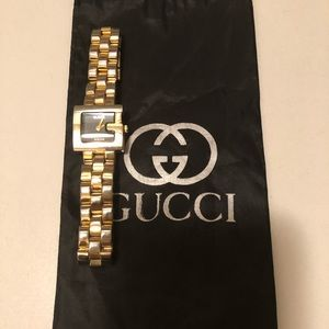Vantage Gucci gold watch with black inside
